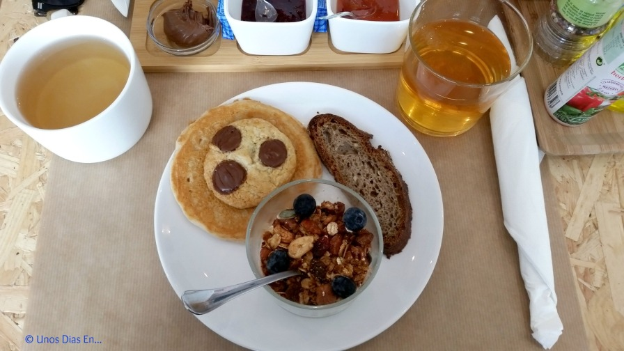 Brunch, pancakes, chocolate chip cookie,granola with soy yogurt and bread.