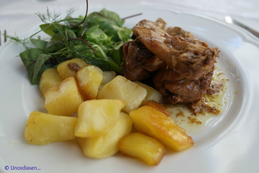 I Gumbi, secondi piatti, rabbit with potatoes and salad.