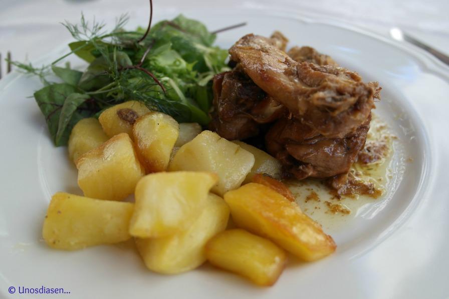 I Gumbi, secondi piatti, rabbit with potatoes and salad.